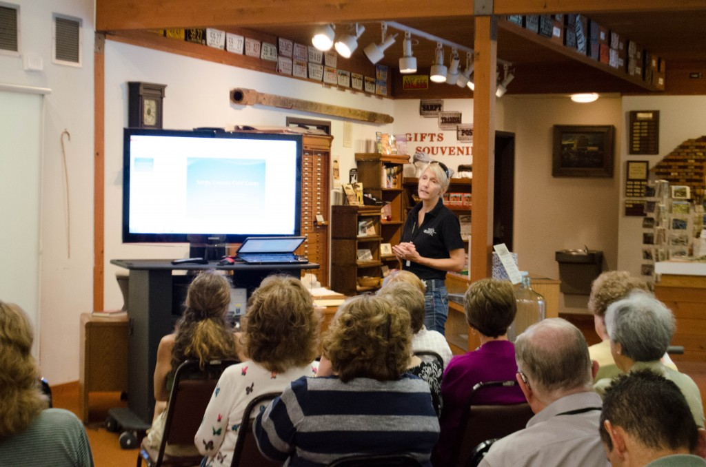 "Museum patrons attend one the program ""Cold Cases of Sarpy County."""
